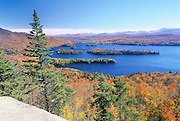 Blue Mountain Lake, Adirondacks, NY 16676.<br /> <br /> Blue Mountain is close to the geographical center of the Adirondacks.  A bit east of the end of the lake is the divide, where waters east flow to the Hudson River Watershed, while westerly flows go to the St Lawrence.  A modest hike brings you halfway down the lake to Castle Rock.  The real estate of the ledge is pretty limited, but what a view over a lake that takes it's color seriously.<br /> <br /> Nikon F5, Nikkor 17-35 f/2.8, 1/1.6 sec @ f/16, Fuji Velvia 50