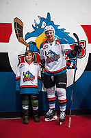 KELOWNA, CANADA - JANUARY 3: Carsen Twarynski #18 of the Kelowna Rockets poses with a minor hockey player after warm up against the Tri-City Americans on January 3, 2017 at Prospera Place in Kelowna, British Columbia, Canada.  (Photo by Marissa Baecker/Shoot the Breeze)  *** Local Caption ***