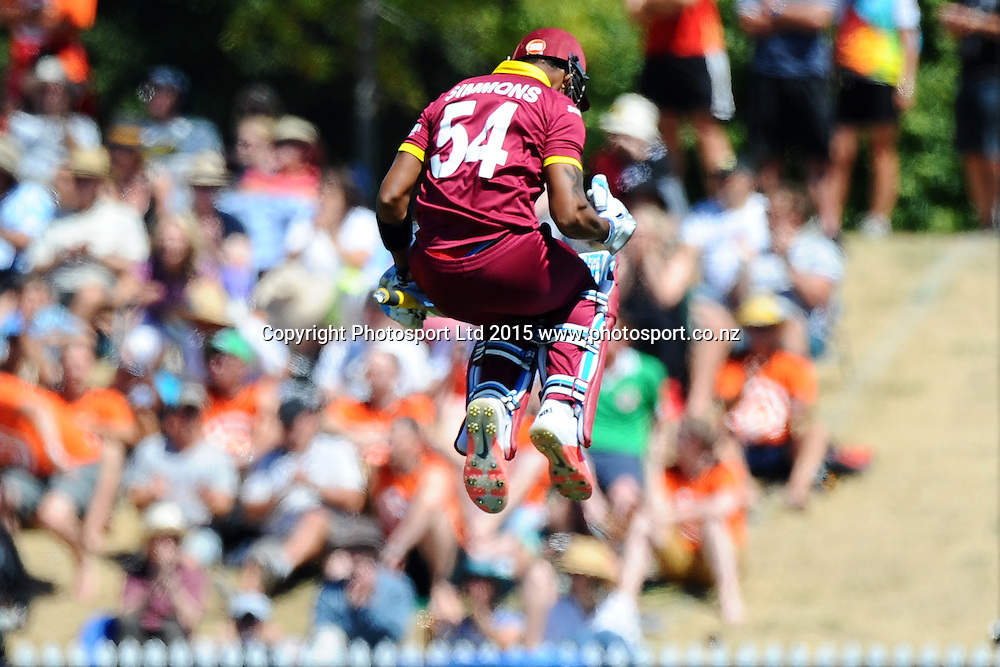 West Indies player Lendl Simmons celebrates his century during the 2015 ICC Cricket World Cup match between West Indies and Ireland. Saxton Oval, Nelson, New Zealand. Monday 16 February 2015. Copyright Photo: Chris Symes / www.photosport.co.nz
