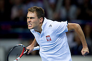 Jerzy Janowicz of Poland reacts after winning second set  at men's single game during the BNP Paribas Davis Cup 2014 between Poland and Croatia at Torwar Hall in Warsaw on April 6, 2014.<br /> <br /> Poland, Warsaw, April 6, 2014<br /> <br /> Picture also available in RAW (NEF) or TIFF format on special request.<br /> <br /> For editorial use only. Any commercial or promotional use requires permission.<br /> <br /> Mandatory credit:<br /> Photo by &copy; Adam Nurkiewicz / Mediasport