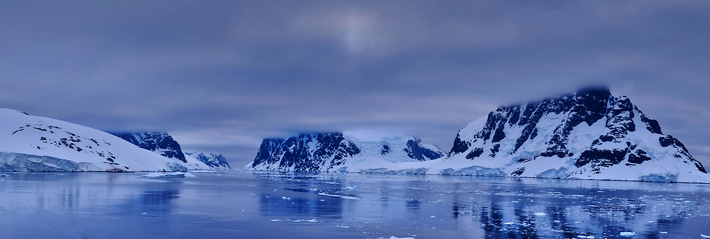 Northern Entrance to the Lemaire Channel in the Southwest Antarctic Peninsula. From the deck of the Hurtigruten MS Fram. In camera panorama taken with a Fuji X-T1 camera and Zeiss 32 mm f/2.8 lens (ISO 200, 32 mm, f/8, 1/180 sec). Jpg image processed with Capture One Pro 8 and Photoshop CC.