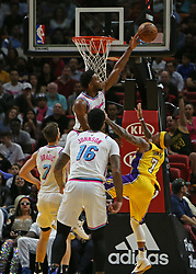 March 1, 2018 - Miami, FL, USA - The Miami Heat's Justise Winslow blocks a shot by the Los Angeles Lakers' Isaiah Thomas during the second quarter at the AmericanAirlines Arena in Miami on Thursday, March 1, 2018. The Lakers won, 131-113. (Credit Image: © David Santiago/TNS via ZUMA Wire)