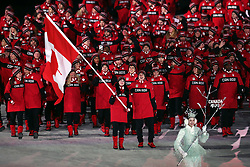 Canada's flag bearers Tessa Virtue and Scott Muir lead of the team during the Opening Ceremony of the PyeongChang 2018 Winter Olympic Games at the PyeongChang Olympic Stadium in South Korea.