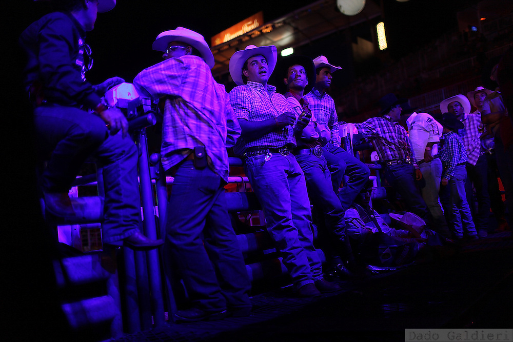 Cowboys wait for their turn to participate in a rodeo competition in Barretos during the Barretos Rodeo Fair in  Sao Paulo state, Brazil, Thursday, Aug. 23, 2012. Brazil is on a quick path to become a global power. Rising economy, big infrastructure projects, an emerging and eager consuming middle class and the booming national industry are the evidences and consequences of the wealth in the southern nation. But the often hidden source of all this wealth falls far from the luring Rio beaches or the Kolkata-New York mix that Sao Paulo is. Behind texan hats and a similar attitude the countrymen display their power through a myriad of projects, festivals and behavior visually analyzed here.