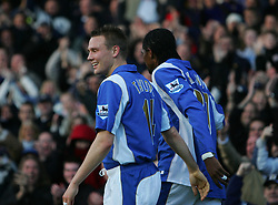 PORTSMOUTH, ENGLAND - SATURDAY, DECEMBER 9th, 2006: Kanu of Portsmouth celebrates scoring the second Portsmouth goal with Matthew Taylor and the corner post against Everton during the Premiership match at Fratton Park. (Pic by Chris Ratcliffe/Propaganda)