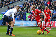 MK Dons midfielder, on loan from Crystal Palace, Jonny Williams  takes on Bolton Wanderers midfielder Josh Vela  during the Sky Bet Championship match between Bolton Wanderers and Milton Keynes Dons at the Macron Stadium, Bolton, England on 23 January 2016. Photo by Simon Davies.