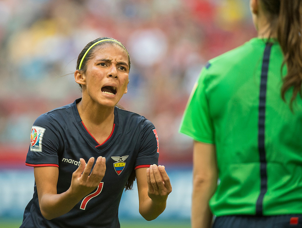 Ingrid Rodriguez of team Ecuador pleads with the referee after a penalty call in 2015 women's World Cup Soccer in Vancouver during the first round action between Cameroon and Ecuador.