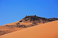 desert sand dune at sunset with blue sky