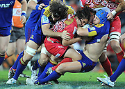 Saia Faingaa runs into the tackle of James Haskell (Blue Headgear) during the Super 15 Rugby (Round 17) fixture between the Queensland Reds and the Otago Highlanders played at Suncorp Stadium (Brisbane) on Friday 6th July 2012 ~ Reds (?) defeated the Highlanders (?) ~ Editorial Use only in accordance with QRU Terms & Conditions ~ Photo Credit Required : Steven Hight (AURA Images/Photosport NZ)