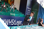 Racing Presenter and Commentator Richard Hoiles calls the horses home on the William Hill St Legerl Game  during the fourth and final day of the St Leger Festival at Doncaster Racecourse, Doncaster, United Kingdom on 14 September 2019.