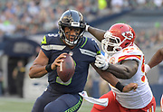 Aug 25, 2017; Seattle, WA, USA; Seattle Seahawks quarterback Russell Wilson (3) is pressured by Kansas City Chiefs defensive end Allen Bailey (97) during a NFL football game at CenturyLink Field. The Seahawks defeated the Chiefs 26-13.