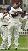 .Sport - Cricket - 22/06/02.Photo Peter Spurrier.Benson & Hedges - Final Lords Essex vs Warwickshire.Wark's wicket keeper Keith Piper celebrates his catch by jumping into the bowler Neil Smith [Mandatory Credit: Peter Spurrier:Intersport Images]