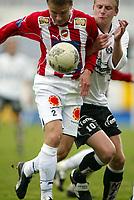 Fotball, 26. april 2003, Tippeligaen, Sogndal-Tromsø 3-1. Tommy Øren, Sogndal, og Svein Morten Johansen, Tromsø