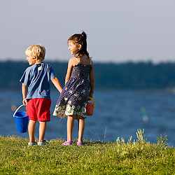 A young brother and sister look at the Atlantic Ocean in Odiorne State Park in Rye, New Hampshire.