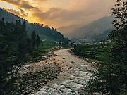 Landscape of a Joginder Nagar valley with Uhl river in Barot, Mandi, Himachal Pradesh during sunset.