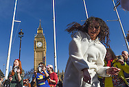 Demonstrators dance in Parliament Square during the Time To Act, National Climate March organised by Campaign Against Climate Change in London, England on March 7, 2015