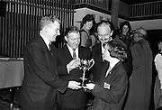 25/04/1964<br /> 04/25/1964<br /> 25 April 1964<br /> Gael Linn Secondary Schools Debating Competition final at the Shelbourne Hotel, Dublin. Annraoi O Braonain, (stiúrthóir Gael Linn) presenting the Gael Linn trophy to the winner of the Individual Speaker Section, Aine Nic Oda, Clochar na Trocaire, Carrick on Suir, Co. Tipperary. Charles Haughey, Minister for Justice (centre) presided at the Finals of the competition. Also in the picture is Donal O'Morain, Ceannasai, Gael Linn.