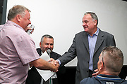 AFC Wimbledon manager Wally Downes meeting Ex Afc Wimbledon player Steve Parsons during the EFL Sky Bet League 1 match between AFC Wimbledon and Wycombe Wanderers at the Cherry Red Records Stadium, Kingston, England on 31 August 2019.