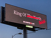 """General overall view of billboard promoting the recruitment Toronto Raptors free agent forward Kawhi Leonard to sign with the LA Clippers along the Interstate 5 freeway, Monday, June 24, 2019, in the Los Angeles suburb of Downey, Calif. The advertisement with a black background reads """"King of the North"""" in white letters with a red line over the North and the world SoCal and  hashtag #KAWHI2LAC."""
