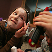 "Maddy Reeves, 12, applies a ""mask"" during a sleepover at her house with her sister and two other girlfriends in Des Moines, Iowa in 2007."