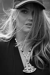 "Princess Diana's niece Lady Kitty Spencer looks like a million dollars in Bvlgari jewels after being snapped up as new ambassador for the luxury Italian brand. The 27-year-old model is following in her aunty's fashionable footsteps and has picked up a string of modeling gigs of late, with industry experts estimating her new deal with Bvlgari could be in the region of £1 million ($1.3 million USD). Earlier this year Kitty, who was just six years old when Princess Diana died in a car crash, starred in her first modeling campaign with Dolce & Gabbana and walked the runway for the brand's Spring/ Summer 2018 collection in March. The new Bvlgari deal now represents a jewel in the crown, quite literally, for the aspiring model, whose recent appearance at the royal wedding of Prince Harry and Meghan Markle raised her profile further with her turn in a stunning green floral D&G dress, teamed with orange heels and a green fascinator. The British aristocrat, who was raised in South Africa as a child before returning to the UK to study, is the daughter of Diana's younger brother Earl Spencer. Speaking about her new partnership with Bvlgari, Kitty said: ""It is an immense honor to be working with the most iconic Italian jewelry brand in the world. ""Bvlgari has always been synonymous with creativity, heritage, beauty and glamour.  I am, therefore, very excited to be part of the Bulgari family, as it means experiencing their passion and magic first-hand."" Since joining the brand, Kitty has been instrumental in helping raise funds for Bvlgari's key charity partners including the Elton John Aids Foundation (EJAF) and Save the Children. Last June, Kitty helped raise £140,000 for the EJAF, when she modeled and introduced the Bvlgari Divas' Dream full pave diamond necklace that was auctioned at their gala in aid for EJAF. Kitty is also hoping to visit some of Save the Children's UK programs later this year, which are supporting young children living in poverty by"
