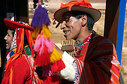 Performer on train from Cuzco to Puno  Peru
