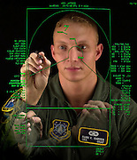 Senior Airman Mark Farmer, a missile warning space console operator at Thule Air Base, Greenland, uses a touch screen monitor to control radar functions. For more information visit http://www.af.mil/news/airman/0901/thule.html ..(U.S. Air Force photo illustration by Tech. Sgt. Lance Cheung)