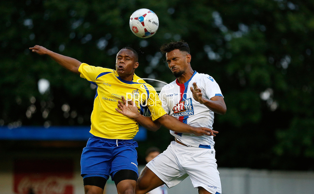 Luke Croll winning the arial battle during the Pre-Season Friendly match between St Albans FC and Crystal Palace at Clarence Park, St Albans, United Kingdom on 21 July 2015. Photo by Michael Hulf.