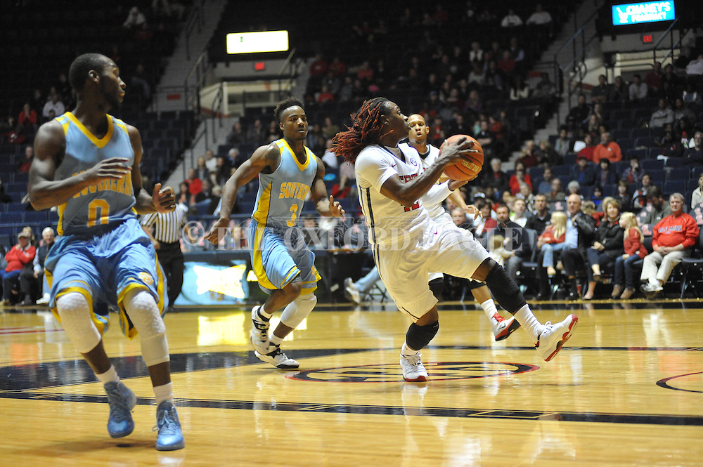 """Ole Miss guard Stefan Moody (42) drives past Southern University Jaguars guard Christopher Hyder (0) to score at the C.M. """"Tad"""" Smith Coliseum in Oxford, Miss. on Thursday, November 20, 2014. (AP Photo/Oxford Eagle, Bruce Newman)"""