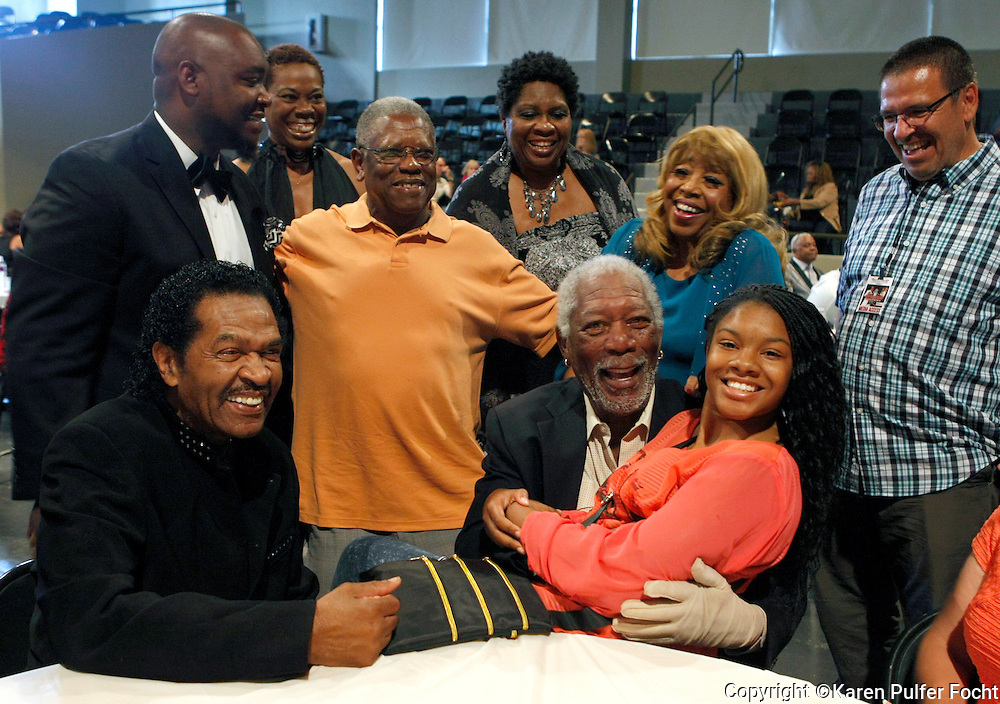 The Rhythm & Blues Lifetime Achievement Award was given to MORGAN FREEMAN, actor and nightclub owner, in Clarksdale, Mississippi on Saturday evening. Entertainer BOBBY RUSH, (left) who headlined the event, was inducted into the hall of fame. Fans at the event took the opportunity to be photographed with the movie star including a young girl, who he sat on his lap.
