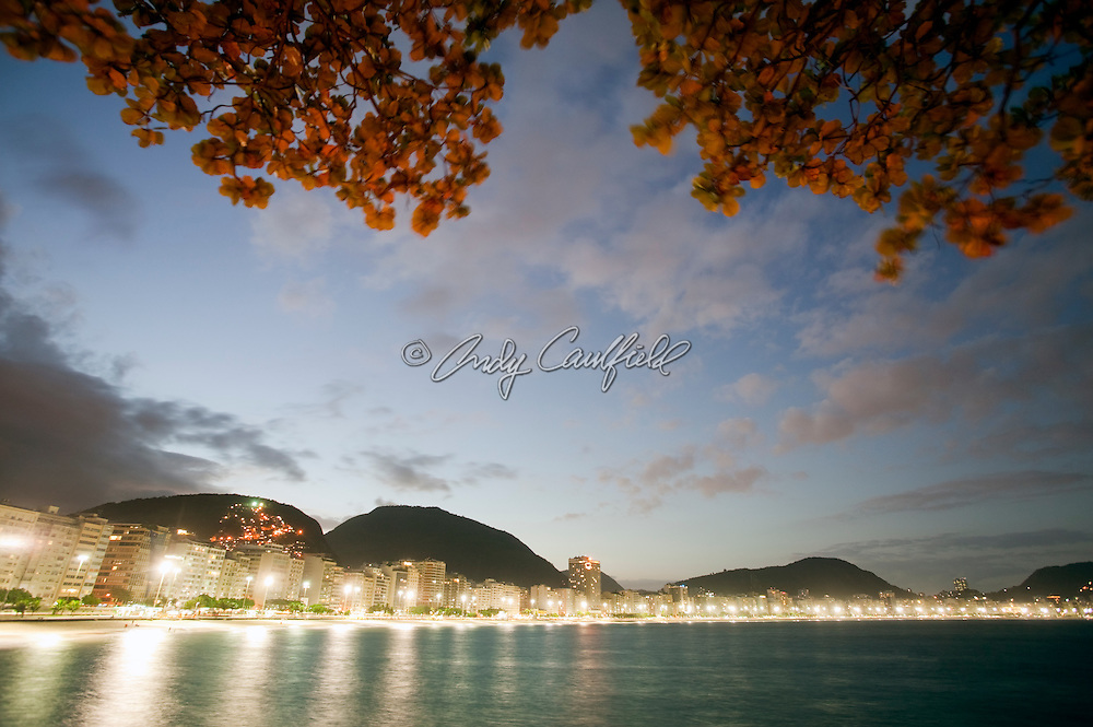 Bright lights of Copacabana beach at dusk with hotels,restaurants and condominums lining Atlantic Ave, Rio de Janeiro, Brazil