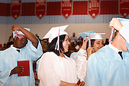 Students turn their tassels during the 55th Annual Belmont High School commencement at the new BHS gymnasium, Saturday, May 19, 2012.  1,700 tickets were sold to the 2012 'Imagine' commencement.