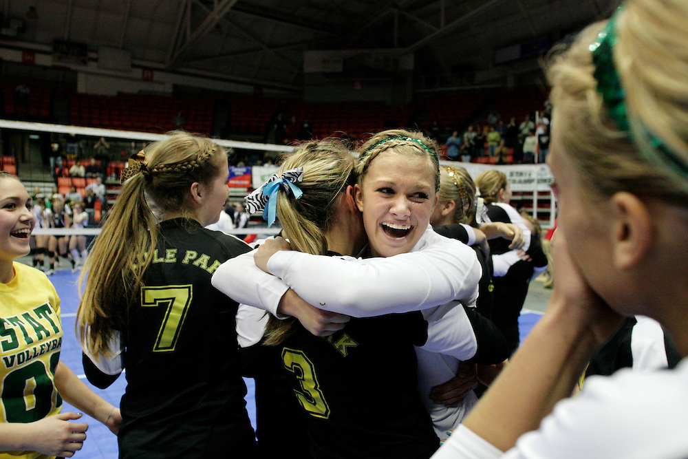 Shadle Park's Kaylee Rector hugs teammate Lindsay Niemeier (3) after Shadle Park's 3A State Championship win Friday night at the Toyota Center in Kennewick.