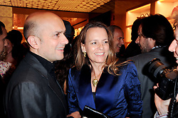 MARC QUINN and GEORGIA BYNG at a party to celebrate the opening of the Louis Vuitton Bond Street Maison, New Bond Street, London on 25th May 2010.