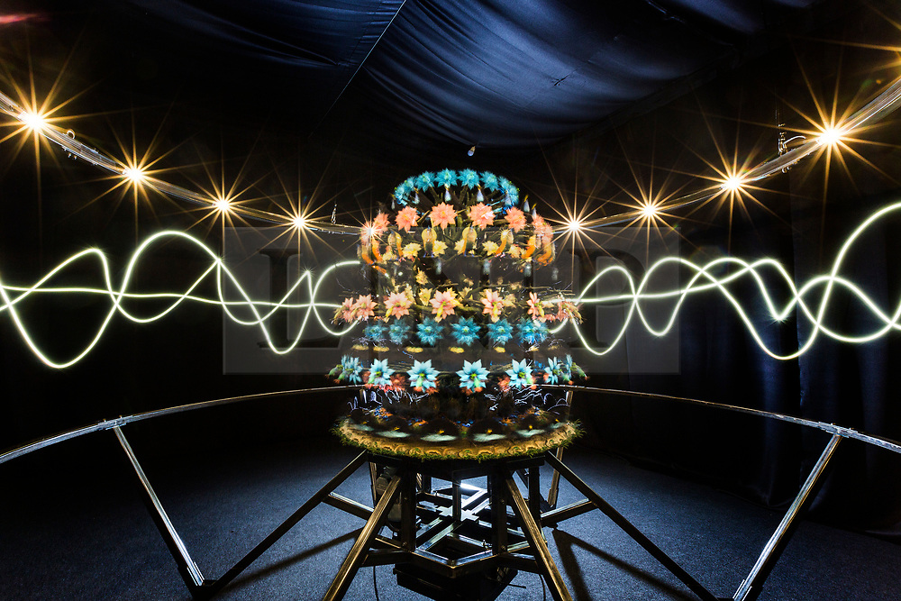 © Licensed to London News Pictures. 23/03/2018. York UK. Picture shows the Mat Collishaw sculpture Zoetrope at Castle Howard this morning. The sculpture produces the illusion of motion through rapid rotation and stroboscopic light. The technology was the precursor to modern film making, animated scenes of bowerbirds and birds of paradise as they perform elaborate mating rituals. The sculpture forms part of a new xehibition at Castle Howard called The Centrifugal Soul & open's on Saturday 24th March. Photo credit: Andrew McCaren/LNP