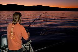 """""""Fishing Lake Tahoe at Sunset 3"""" - This man was photographed fishing for Mackinaw on Lake Tahoe at sunset."""