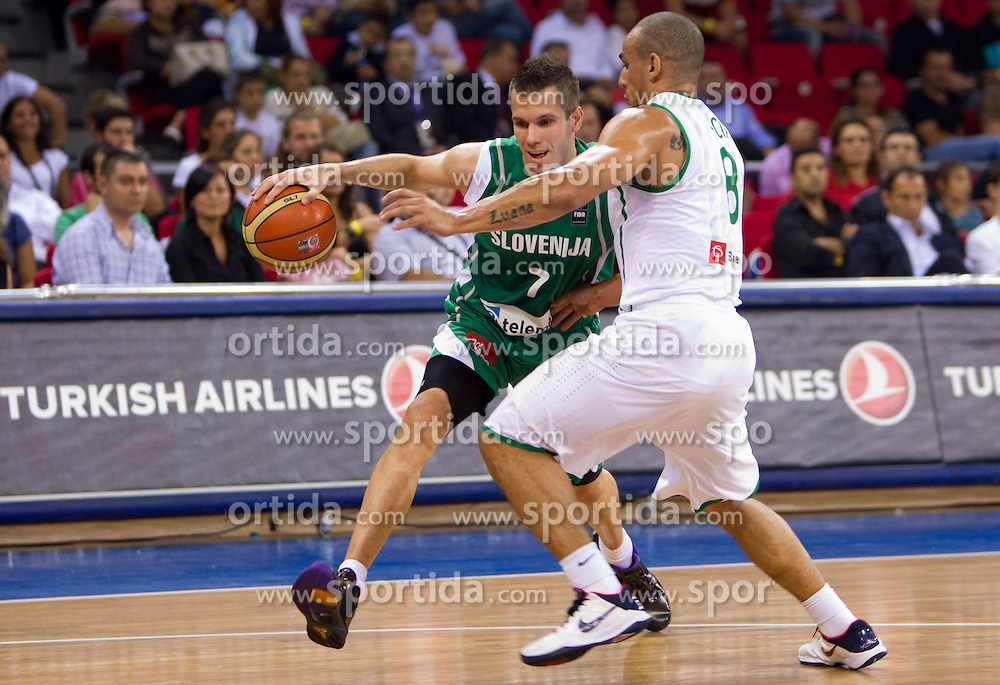 Sani Becirovic of Slovenia vs Alex Garcia of Brasil during  the Preliminary Round - Group B basketball match between National teams of Slovenia and Brasil at 2010 FIBA World Championships on September 1, 2010 at Abdi Ipekci Arena in Istanbul, Turkey. (Photo By Vid Ponikvar / Sportida.com)