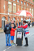 Fans purchase match day programmes before the EFL Sky Bet Championship match between Fulham and Queens Park Rangers at Craven Cottage, London, England on 1 October 2016. Photo by Jon Bromley.