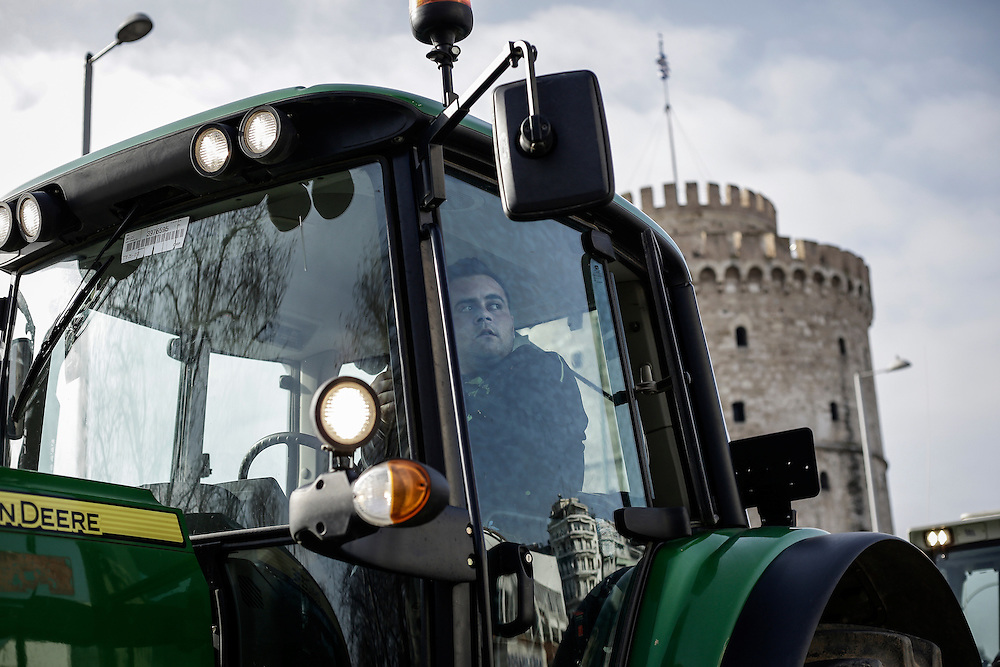 A farmer with his tractor in front of the white tower during a march inside the city of Thessaloniki, Greece, on the 2nd of February 2017. Farmers from around northern Greece gathered in Thessaloniki during the opening of the Zootechnia international livestock to demonstrate against the austerity measures put by the Greek government.