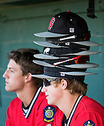 Grand Island Home Federal's Christian Valverde wears the ultimate rally cap late in Tuesday's A-6 senior district game against Columbus at Ryder Park in Grand Island. Columbus defeated Grand Island Home Federal 6-4 in 11 innings. (Independent/Matt Dixon)