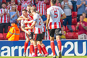 Chris Maguire (#7) of Sunderland AFC celebrates with team mates after scoring the third goal for Sunderland during the EFL Sky Bet League 1 match between Sunderland and AFC Wimbledon at the Stadium Of Light, Sunderland, England on 24 August 2019.