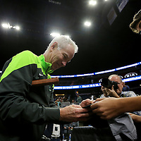 Tennis champion John McEnroe signs an autograph as he leaves the court during the PowerShares Tennis Series event at the Amway Center on January 5, 2017 in Orlando, Florida. (Alex Menendez via AP)