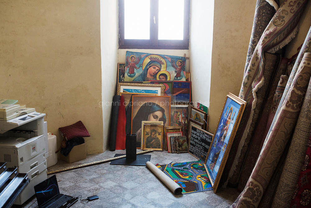 ROME, ITALY - 16 NOVEMBER 2014: Icons of the Orthodox Tewahedo Church are stored in a room of the Church of Saints Joachim and Anne in the Monti neighborhood in Rome, Italy, while the sunday mass takes place in the basement of the building, on November 16th 2014.