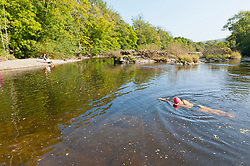 © Licensed to London News Pictures. 17/09/2020.  Builth Wells, Powys, Wales, UK. As the heatwave continues in Wales, a family cool off in the river Wye at the wild swimming location known as Penddol Rocks near Builth Wells in Powys, UK. Photo credit: Graham M. Lawrence/LNP