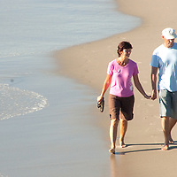A couple strolls along the Santa Monica shoreline on Monday, December 13, 2010.