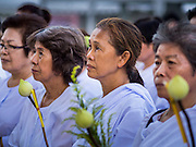 04 MARCH 2015 - BANGKOK, THAILAND: Women dressed in white prepare to enter the prayer hall for services at Wat Benchamabophit on Makha Bucha Day. Makha Bucha Day is an important Buddhist holy day and public holiday in Thailand, Cambodia, Laos, and Myanmar. Many people go to temples to perform merit-making activities on Makha Bucha Day. Wat Benchamabophit is one of the most popular Buddhist temples in Bangkok.    PHOTO BY JACK KURTZ