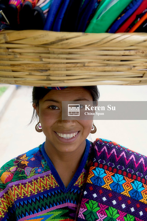 Portrait of woman carrying basket, Antigua, Guatemala