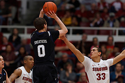 Dec 22, 2011; Stanford CA, USA;  Butler Bulldogs guard/forward Andrew Smeathers (0) shoots over Stanford Cardinal forward Dwight Powell (33) during the first half at Maples Pavilion.  Mandatory Credit: Jason O. Watson-US PRESSWIRE