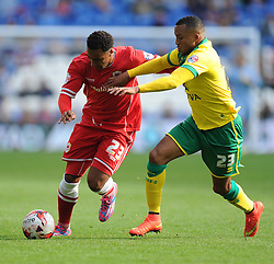 Cardiff City's Nicky Maynard battles for the ball with Norwich's Martin Olsson - Photo mandatory by-line: Alex James/JMP - Mobile: 07966 386802 30/08/2014 - SPORT - FOOTBALL - Cardiff - Cardiff City stadium - Cardiff City  v Norwich City - Barclays Premier League