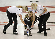 TREVOR HAGAN - Leslie Wilson and Raunora Westcott sweep for their skip, Cathy Overton-Clapham during the Scotties Provincial Curling Championships in Altona.<br /> January 28, 2011